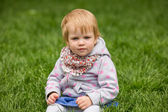 Young adorable cheerful baby playing in park — Stock Photo