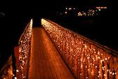 Night wooden bridge with a garland — Zdjęcie stockowe