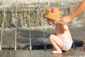 Toddler drinking from the water fountain in the summertime. — Stock Photo