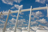 Part of the football stadium on a sky with clouds — Stock Photo