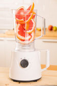Grapefruit white Blender on a wooden table. — Stock Photo