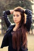 Beautiful female model in park — Stock Photo