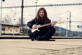 Young girl with a guitar — Foto de Stock