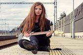 Young girl with a guitar — Foto Stock