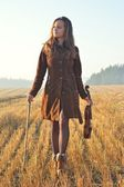 Girl on a walk with Violin — Stock Photo