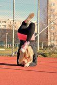Young blond girl dancing break dance — Stock Photo