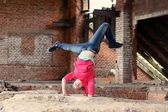 Teenager dancing in the old brickworks — Stock Photo