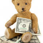 Teddy bear with Dollar Bills — Stock Photo #40022455