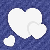White paper hearts on a blue jeans background — Stock vektor