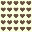 Seamless pattern with cute brown hearts on a yellow background — Stock Vector