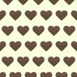 Seamless pattern with many brown hearts on a yellow background — Stock Vector