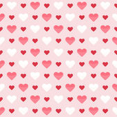 Seamless pattern with cute colorful hearts on a pink — Vecteur
