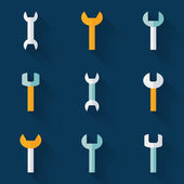 Flat wrench icon set over blue — Stock vektor