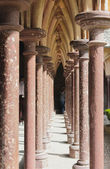Colonnade in medieval castle. San Michel, France — Stock Photo