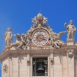 Hours and bell on St. Peter's Cathedral facade. Vatican, Rome, Italy — Stock Photo