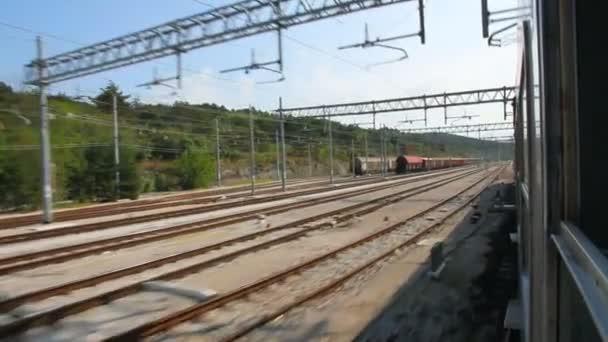 View from train window on electrified tracks. Italy, Friuli-Venice-Julia province — Vídeo de stock