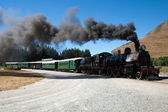 A vintage steam train departure in New Zealand outback — 图库照片