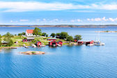 Small village with red buildings in Finnish archipelago — Stock Photo