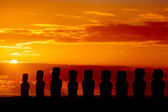 Nine standing moais in orange sunset in Easter Island — Stock Photo
