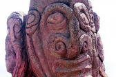 Red carving of a face on a moai in Easter Island — Stock Photo