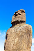 Close-up of a stone moai in Easter Island against bright blue sky — Stock Photo