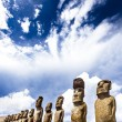 Stock Photo: Moais standing on ahu with dramatic clouds in background in Easter Island