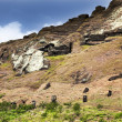 Stock Photo: Heads of moais on Rano Raruku mountain in Easter Island