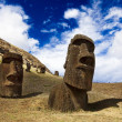Stock Photo: Heads of buried moais standing on mountain in Easter Island