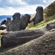 Stock Photo: Moai heads and laying moai in Rano Raruku mountain in Easter Island