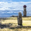 Stock Photo: Two Moais in sebank in Easter Island