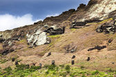 Heads of moais on Rano Raruku mountain in Easter Island — Stock Photo