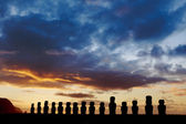 Fifteen standing moais against dramatic evening sky in Easter Island — Stock Photo
