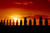 Standing moais against red and orange sunset — Stock Photo