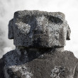 Stock Photo: Massive moai head against cloudy sky