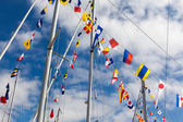 Colourful signal flags on a sailing boat — Stock Photo