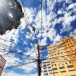 View from below of electrical lines on power pole in Rio de Jane — Stock Photo