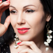 Beautiful closeup portrait of a young fashion woman. Beautiful makeup in retro style. Fashion jewelry. — Stock Photo