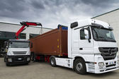 Crane, trucks and container — Stock Photo
