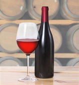 Red wine bottle, one glass — Stockfoto