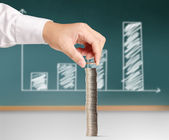 Hand put coin to money — Stock Photo