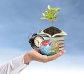 Holding earth and Education — Stock Photo