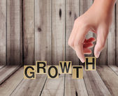 Hand and word growth — Stock Photo
