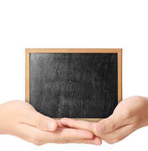 Holding blank chalkboard in hand — Stock Photo