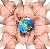 Earth in human hand — Stock Photo