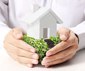 Holding house in hand — Stock Photo