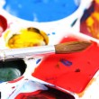 Artists palette with various colour paints and brush — Stock Photo #40410891