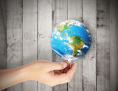 Earth in human hand against — Stock Photo
