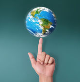 Globe in human hand — Stock Photo