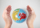 """Earth in human hand """"Elements of this image furnished by NASA"""" — Stock Photo"""