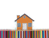 Draw with an house wity colorful pencils — Stock Photo